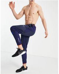 Nike Темно-синие Джоггеры Wild Run Phemon Elite-темно-синий