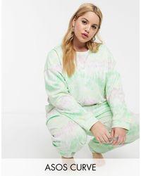ASOS ASOS DESIGN Curve – Set mit Sweatshirt und Jogginghose mit Batikmuster - Grün