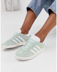 adidas Originals Superstar Slip On Trainers In White And Orange