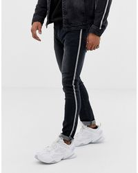 Liquor N Poker Skinny Jeans With Metalic Sport Stripe - Black