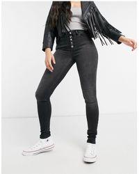ONLY – Eng geschnittene Jeans mit hohem Bund und sichtbaren Knöpfen - Schwarz