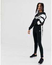 d465c77c1 adidas Originals - Joggers negros de corte slim con raya en el lateral de -  Lyst