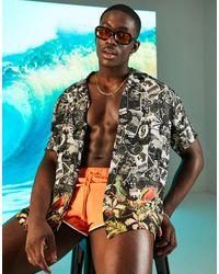 ASOS Camisa holgada con ribete, estampado figurativo y cuello con solapas - Multicolor