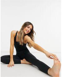 Nike Укороченный Присборенный Комбинезон Длиной 7/8 Черного Цвета Nike Yoga Luxe-черный Цвет