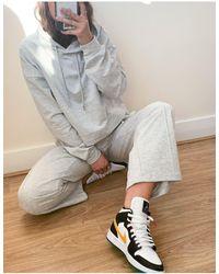 ASOS Survêtement avec hoodie et jogger droit à nervures - chiné - Gris