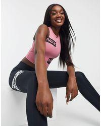 Nike Nike Pro Training Crop Top With Logo Taping - Pink