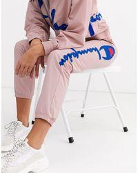 Champion – Jogginghose mit großem Logo, Kombiteil - Pink