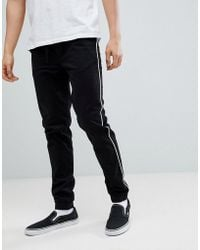 ASOS - Design Skinny Woven Joggers In Black With White Piping - Lyst