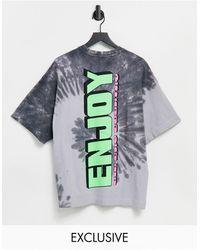 Collusion Camiseta extragrande con efecto tie dye y estampado neón - Azul