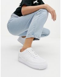 85b10fea920 Nike Air Force 1 Trainers In White And Blue in White - Lyst