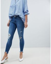 River Island - Amelie Distressed Skinny Jeans In Mid Wash - Lyst