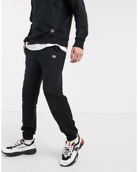 Russell Athletic – Ernie – Jogginghose mit Bündchen - Schwarz