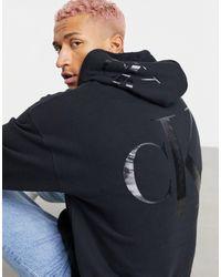 Calvin Klein Felpa con cappuccio nera con logo grande sul retro - Nero
