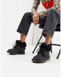 Dr. Martens 1460 Kolbert Snowgrip - Flache Ankle-Boots aus schwarzem Leder