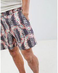 ASOS Pantalones cortos slim con cinturilla elástica y estampado animal - Negro