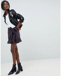 ba0a39768365da Blank NYC Zip Through Mini Leather Look Skirt in Black - Lyst