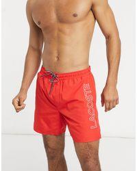 Lacoste – Badeshorts mit integrierten Boxershorts - Rot