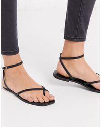 ASOS Farnborough - Sandales plates minimalistes avec boucle au bout - Noir