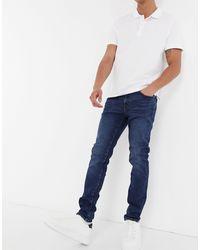 SELECTED – Eng geschnittene Jeans aus Bio-Baumwolle - Blau