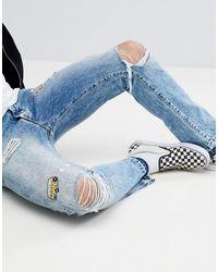 Wrangler Boyton - Jeans affusolati con applicazione stile vintage - Blu