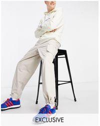 Collusion Pantalon d'ensemble coupe baggy style années 90 - Taupe - Blanc
