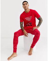 """ASOS Pijama con meggings confort y camiseta con estampado """"meet me under the mistletoe"""" - Rojo"""