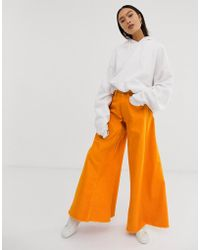 ASOS Wide Leg Jeans With Godet Insert Detail Jeans In Washed Orange