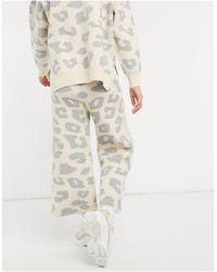 Never Fully Dressed Pantalon oversize d'ensemble en maille à imprimé animal - Crème - Neutre