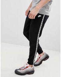 Nike - Joggers skinny neri con fettucce AR4912-010 - Lyst