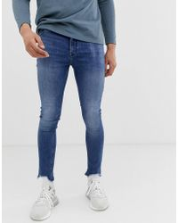 ASOS - Spray On Jeans In Power Stretch With Raw Hem In Blue - Lyst