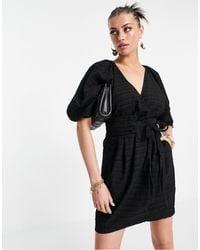Mango Vestido negro cruzado con mangas abullonadas