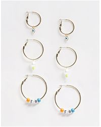 ASOS Pack Of 3 Hoop Earrings With Faux Pearl And Letter Bead Charms Be You - Metallic