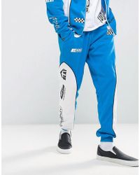 Jaded London - Skinny Joggers In Blue With Racing Print - Lyst