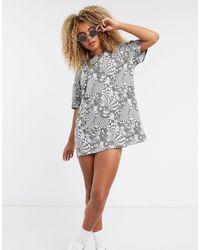New Girl Order Vestito T-shirt con stampa psichedelica monocromatica - Multicolore
