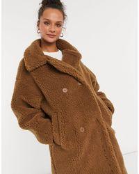 Monki Manteau duveteux en imitation peau - Marron