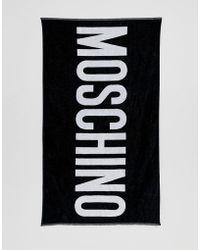 Moschino Serviette de plage avec logo - Noir