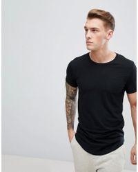 Produkt T-shirt long avec ourlet arrondi - Noir