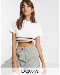 New Balance Utility Pack - T-shirt crop top - - Exclusivité ASOS - Blanc