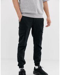 Jack & Jones Intelligence - Pantaloni cargo neri con fondo elasticizzato - Nero
