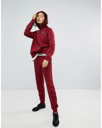 Nike - Rally Tight Fit Joggers In Burgundy - Lyst