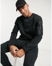 Nike Sudadera negra con cuello redondo en tejido - Negro