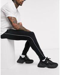 ASOS Joggers skinny avec passepoil - Noir