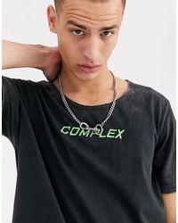 ASOS T-shirt délavé à l'acide avec encolure dégagée et broderies fluo - Noir