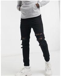 Bershka Denim Jeans Met Scheuren - Zwart