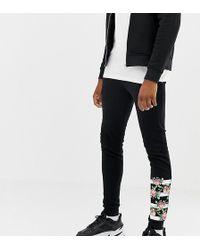 33c94c0027 Joggers super skinny con tasche zip oro rosa e stampa - Nero