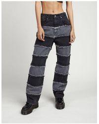 The Ragged Priest Jeans a vita alta con righe di jeans effetto patchwork - Nero
