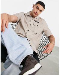 Calvin Klein Светло-бежевая Походная Рубашка С Короткими Рукавами Из Технологичного Материала -светло-бежевый Цвет - Многоцветный