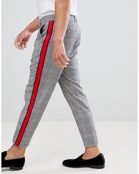 Bershka Pantalones grises con diseño a cuadros y rayas laterales