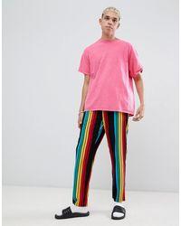 ASOS – Gewebte, gerade geschnittene Pyjamahose mit Regenbogenstreifen - Schwarz