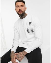 Pull&Bear T-shirt à manches longues imprimé dans le dos - Blanc